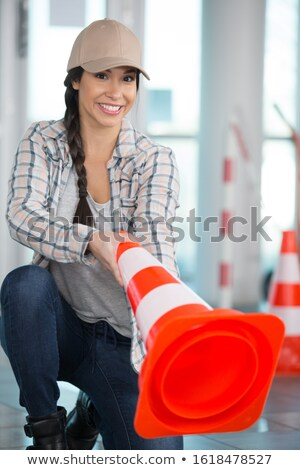 Female builder holding traffic cone Stock photo © photography33