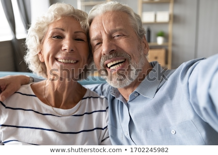 loving senior couple posing with hand in hand stock photo © stockyimages
