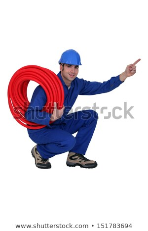 squatting construction worker pointing his finger stock photo © photography33