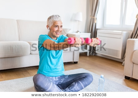 senior woman doing exercises with a dumbbell stock photo © photography33