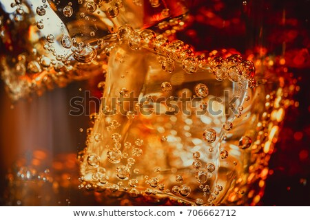 cola with ice cubes close up stock photo © ozaiachin