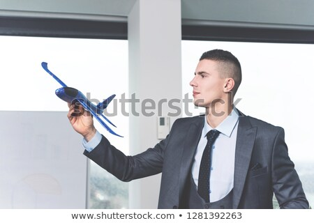 Businessman joyful leaning on an airplane Stock photo © photography33