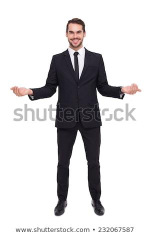 mosolyog · üzletember · öltöny · nyitva · kezek · vonzó - stock fotó © scheriton