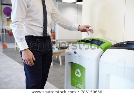Stock photo: Man holding recycling bin