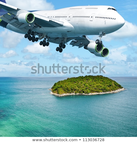 Jumbo jet over the tropical island. Square composition. Stock photo © moses