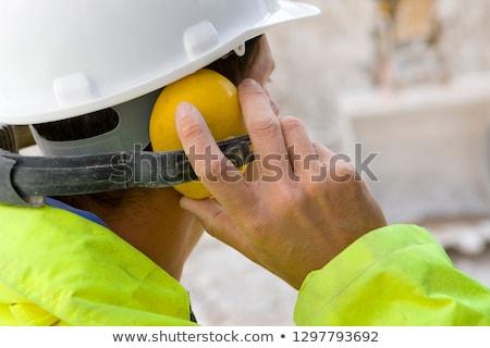 Férfi visel fül építkezés fejhallgató portré Stock fotó © photography33