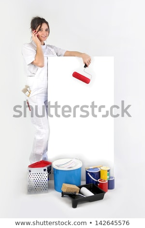 Decorator using a cellphone next to a blank board Stock photo © photography33