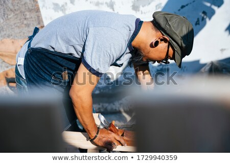 Man sawing through wooden frame Stock photo © photography33