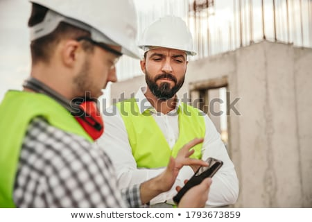 Laborer with mobile phone Stock photo © photography33