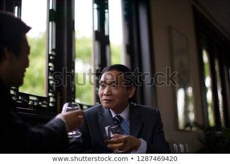 Man sat drinking red wine Stock photo © photography33