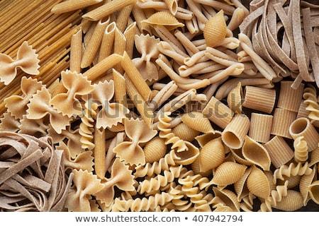 Teljeskiőrlésű tészta válogatás fából készült tálak piros Stock fotó © ivonnewierink