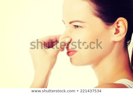 嫌悪 · 若い女性 · 見える · 着色した · シャツ · 白 - ストックフォト © wavebreak_media