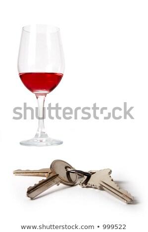 Red wine glass with car keys Stock photo © Zerbor
