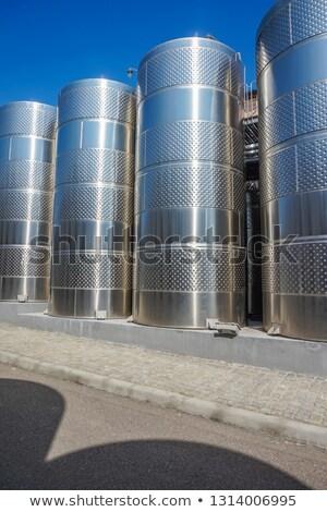 vloeibare · store · roestvrij · staal · wijn · druivensap · blauwe · hemel - stockfoto © lunamarina