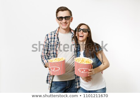 Expressive young woman watching 3d film Stock photo © HASLOO