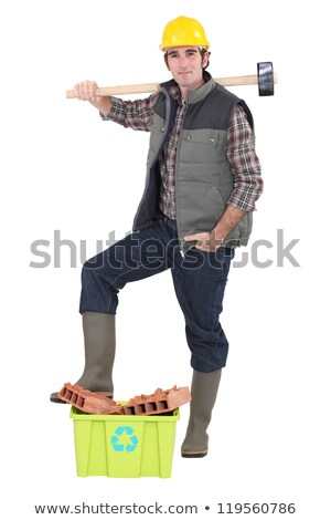 Stock photo: Builder stood by waste construction material