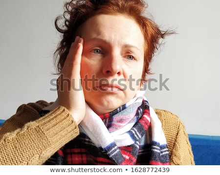 red haired woman with thermometer stock photo © ivonnewierink
