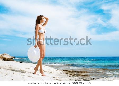 Gyönyörű nő pózol fehér bikini vakáció szépség Stock fotó © dolgachov