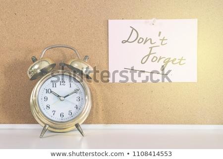 Alarm clock with sticky paper  Stock photo © natika