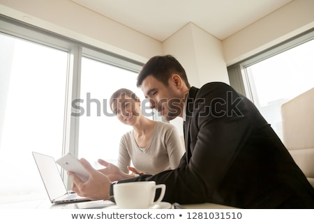business man sync smart phone with tablet PC Stock photo © tungphoto