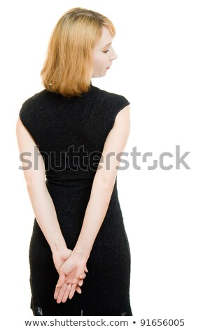Rear view of a young woman thinking with her hands behind back Stock photo © bmonteny