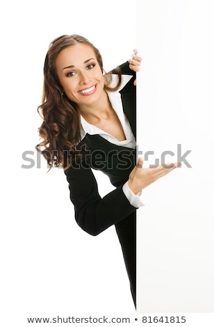 Stock photo: Young woman showing a blank placard and smiling