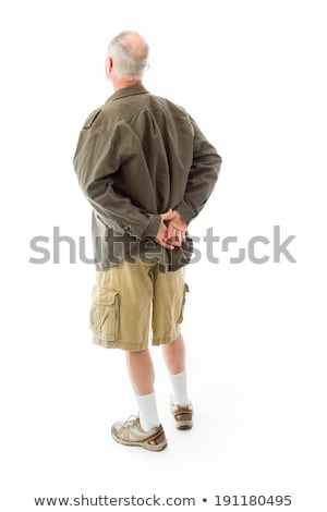 Rear view of a senior man standing with his hands behind back Stock photo © bmonteny