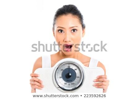 Asya kadın umutsuzluk ağırlık genç ölçek Stok fotoğraf © Kzenon