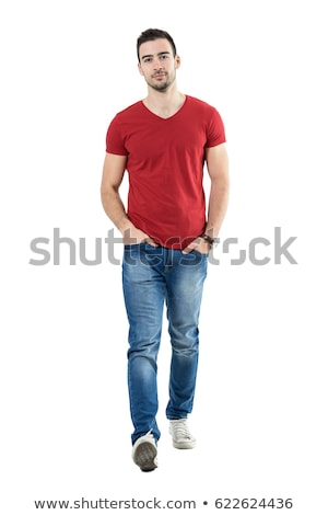 Full length portrait of a fashion man walking forward Stock photo © deandrobot