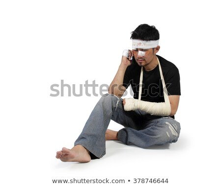Injured Man with Head Bandages using Mobile Phone Stock photo © stevanovicigor