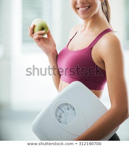 улыбающаяся · женщина · масштаба · улыбаясь · ухода · веса · пациент - Сток-фото © wavebreak_media