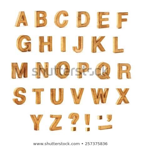 Wooden punctuation marks set isolated on white background. Stock photo © Leonardi