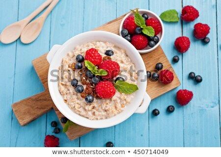 Blackberries on blue plate on wooden background Stock photo © gigra