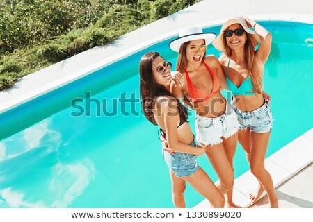 Maiô estância termal mulher piscina Foto stock © lunamarina