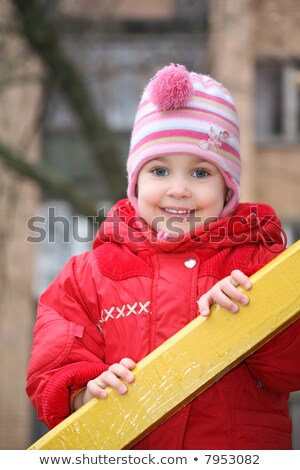 the portrait of girl, who is held for the wooden rails Stock photo © Paha_L