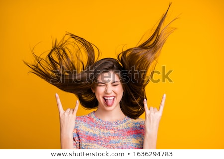 Beautiful young woman shows flying gesture Stock photo © Aikon