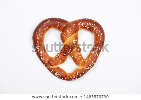 кренделек тмин соль хлеб белом фоне Сток-фото © Digifoodstock