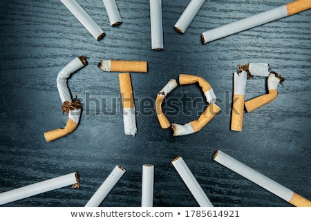Quit smoking concept, flat lay arranged cigarettes Stock photo © stevanovicigor