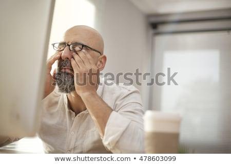 Cansado mais velho homem óculos 60 anos Foto stock © PixelsAway
