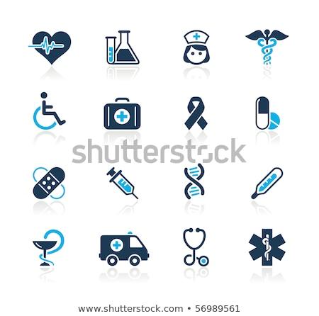 medical icon with syringe and test tube stock photo © biv