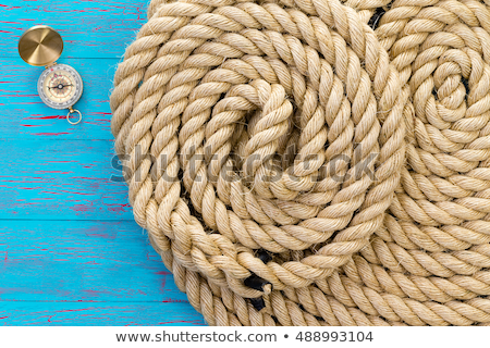 Two neatly coiled ropes and a magnetic compass Stock photo © ozgur