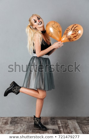 full length of beautiful blonde young woman with halloween makeup stock photo © deandrobot