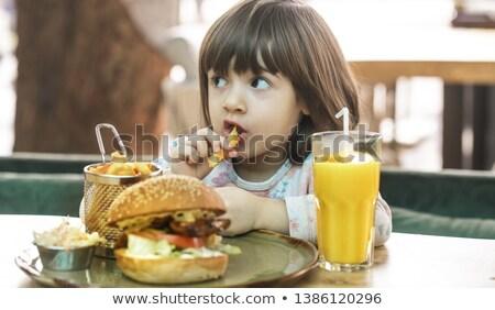 Cute girl having cheeseburger Stock photo © bluering