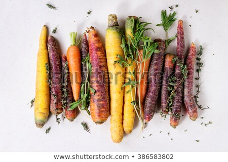 Bunch of colorful organic carrots with green tops Stock photo © ozgur