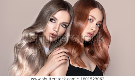 Two beautiful girls with bright makeup and curly hair Stock photo © svetography