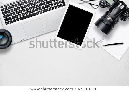 office desk with camera pc and notepad stock photo © karandaev