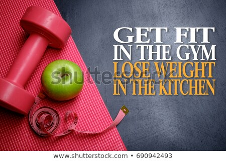 Fitness equipment on a dark background - Lose weight successfull Stock photo © Zerbor