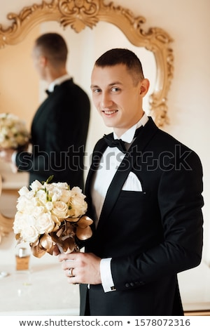 happy man posing near the mirror stock photo © deandrobot