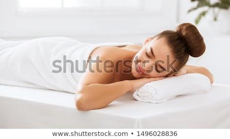 Beautiful young woman relaxing in a spa resort Stock photo © Yatsenko