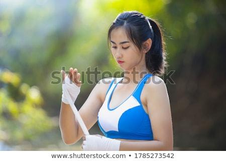 Boksör spor bayan ayakta poz spor salonu Stok fotoğraf © deandrobot
